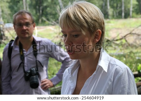 Khimki, Moscow region, Russia - August 19, 2012. Ecologist Eugene Chirikov gives interviews to journalists. Representatives of different political forces gathered to propose the single candidate