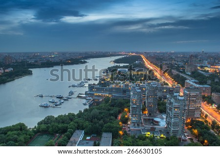 Khimki reservoir, residential district and city road at evening in Moscow, Russia. - stock photo
