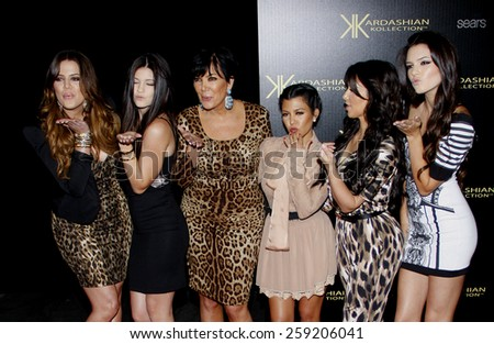 Khloe, Kim and Kourtney Kardashian, and Kris, Kendall and Kylie Jenner at the Kardashian Kollection Launch Party held at the Colony in Los Angeles, California, United States on August 17, 2011.  - stock photo