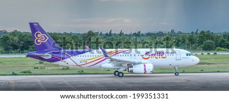 KHONKAEN, THAILAND- JUNE 7, 2014 : HS-TXM Airbus A320-200 of Thai smile airways taxiing to runway for flying to Suvarnabhumi airport, Bangkok. - stock photo