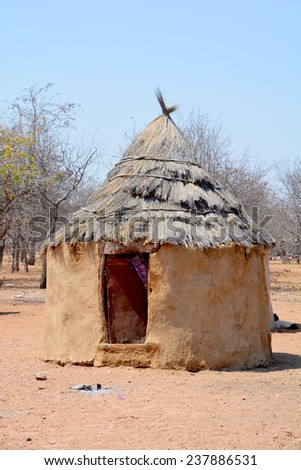 KHORIXAS, NAMIBIA OCTOBER 09, 2014: . Himba house. The Himba are indigenous peoples living in northern Namibia, in the Kunene region of South-West Africa on october 09 2014  - stock photo