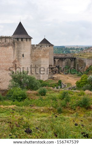 KHOTYN, UKRAINE - AUGUST 26, 2013 The view on Khotyn fortress towers and the bridge, on August 26, 2013 in Khotyn.