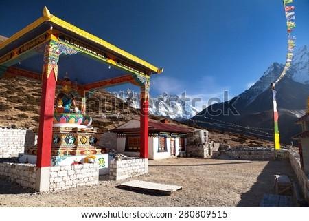 KHUMBU, NEPAL, 5th DECEMBER 2014 - View of new statue of buddha in Pangboche monastery and mount Lhotse, Khumbu valley near Tengboche, way to Everest base camp, Nepal - stock photo