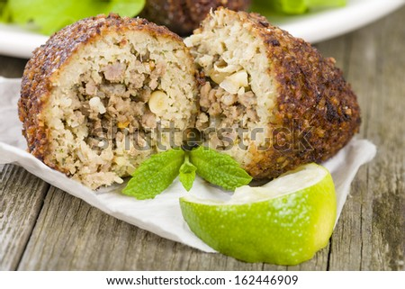 Kibbeh - Middle Eastern minced meat and bulghur wheat fried snack. Also popular party dish in Brazil (kibe). - stock photo
