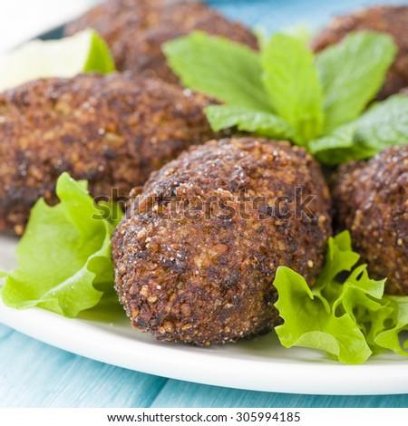 Kibbeh - Middle Eastern minced meat and bulghur wheat fried snack. Also popular party dish in Brazil (kibe).