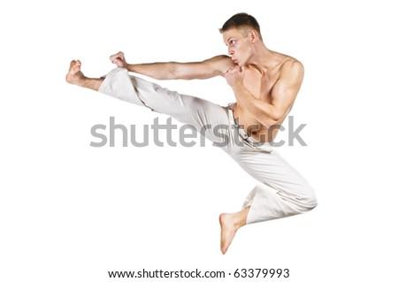 Kick boxer punching, isolated on white background. - stock photo