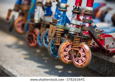 Kick scooter wheels, close up, vintage style - stock photo