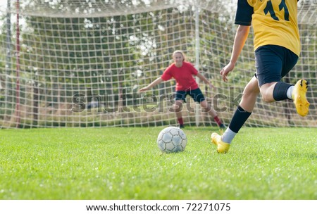 kicking and  Defending in soccer - stock photo