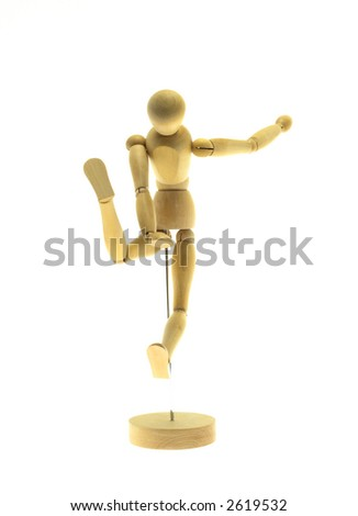 Kicking wood mannequin on a white background - stock photo