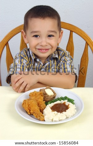 Kid and fried chicken - stock photo