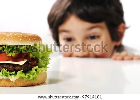 Kid and hamburger - stock photo