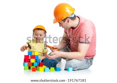 kid and his dad play with building blocks - stock photo