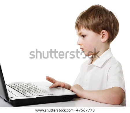 Kid and laptop - stock photo