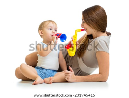 kid and mother play musical toys isolated - stock photo