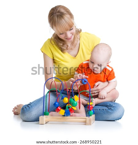 kid and mother playing with educational toy
