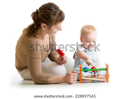 kid and mother playing  with musical toy isolated - stock photo