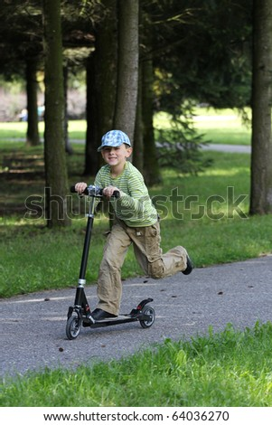 Kid and scooter - stock photo