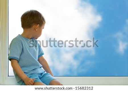 Kid and sky - stock photo
