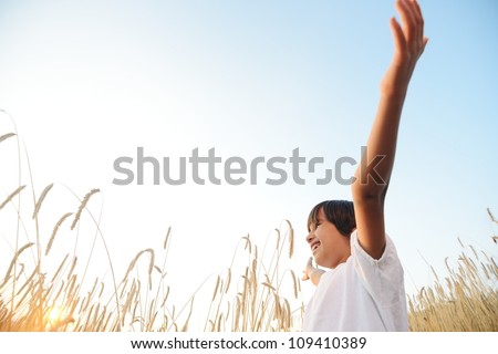 Kid at wheat field - stock photo