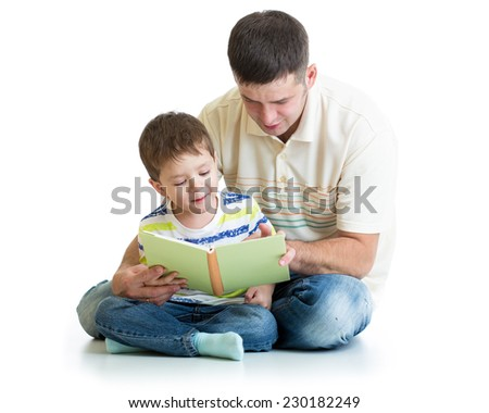 kid boy and his dad read a book together - stock photo