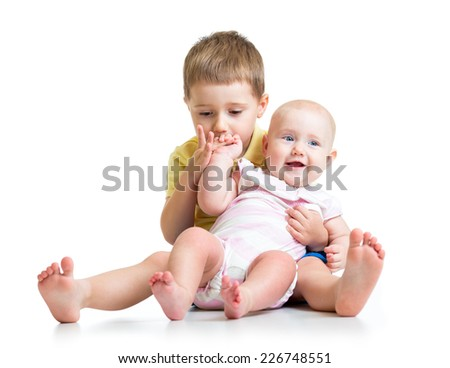 Kid boy and his sister baby girl isolated on white background - stock photo