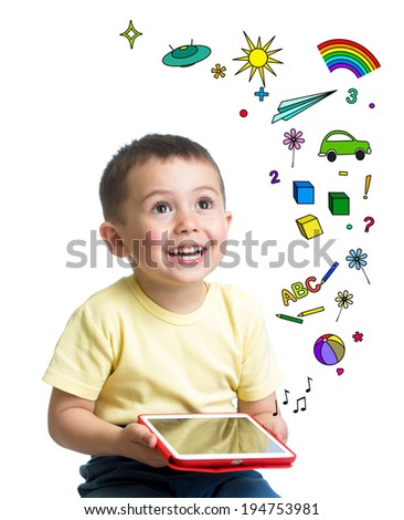 kid boy holding a tablet pc in hands and looking up - stock photo