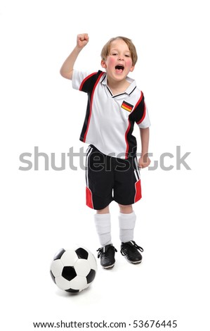 Kid / Boy in complete german soccer outfit cheers - stock photo