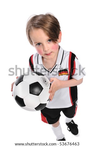 Kid / Boy in complete german soccer outfit holding a soccer ball - stock photo