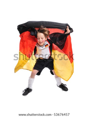 Kid / Boy in complete german soccer outfit jumps with a german flag - stock photo