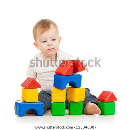kid boy playing with construction set blocks isolated on white background