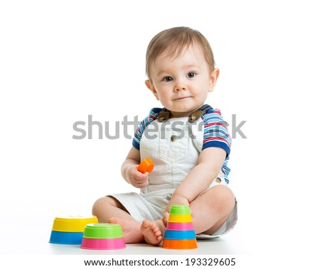kid boy playing with toy isolated on white background - stock photo