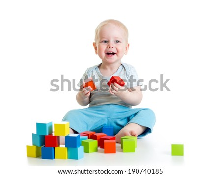 kid boy playing  wooden toys - stock photo