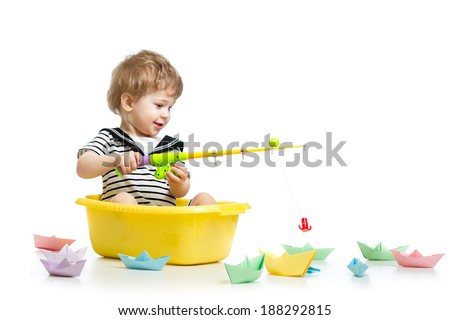 Kid boy plays fishing - stock photo