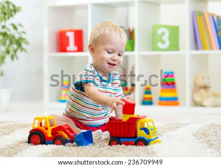 kid boy toddler playing toys at home