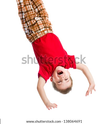 kid boy upside down isolated on white - stock photo