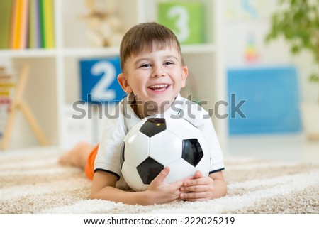 kid boy with soccerball  indoor - stock photo