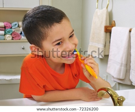 kid brushing teeth, looking in bathroom mirror