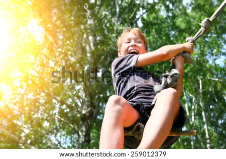 Kid Bungee jumping in the Summer Forest - stock photo