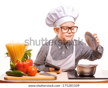 kid chef is cooking on the kitchen - stock photo