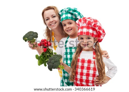 Kid chefs helping their mother preparing healthy food - holding vegetable ingredients, isolated - stock photo