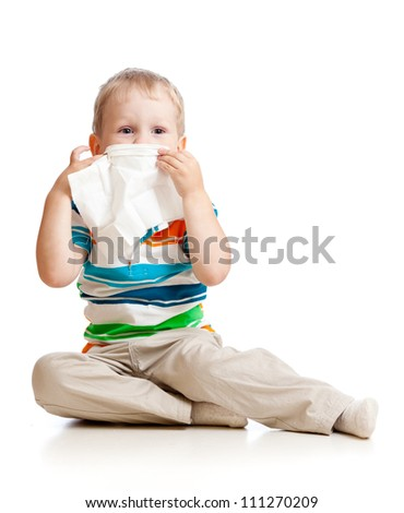 kid cleaning nose with tissue isolated on white - stock photo