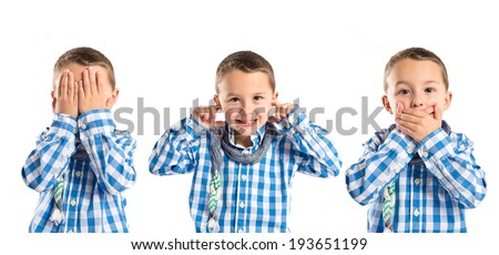Kid covering his mouth, his ears, and his eyes  - stock photo