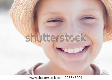 kid cute straw hat happy smile portrait close up outdoor - stock photo