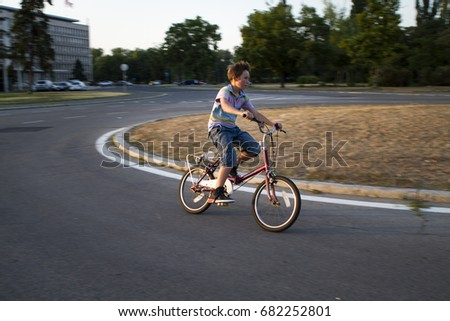 Kid cycling