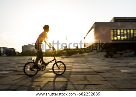 kid cycling sunset