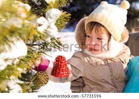 Kid decorating Christmas tree - stock photo