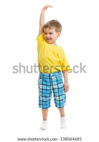 Kid demonstrating growing. Isolated on white studio shot. - stock photo