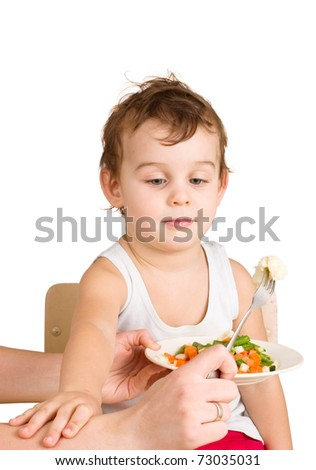 Kid does not want to eat salad - stock photo