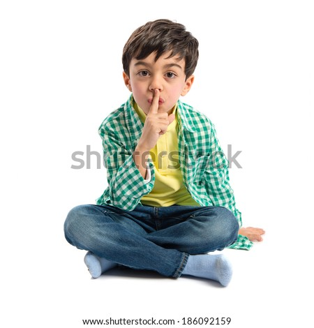 Kid doing silence gesture over white background  - stock photo
