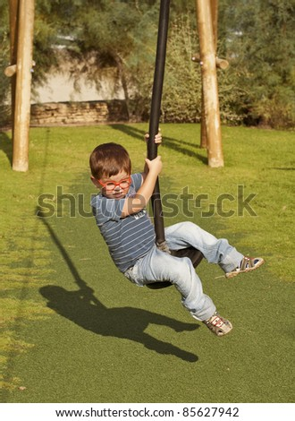 Kid doing summer fun sport on rope slide